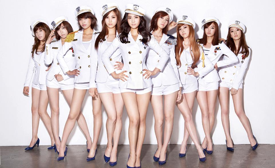 Girls Generation girl group wearing white uniforms and blue heels